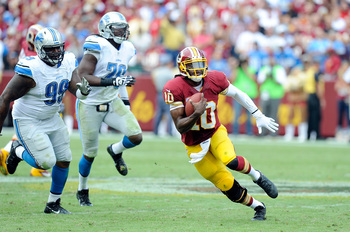 Hi-res-181576767-robert-griffin-iii-of-the-washington-redskins-runs-with_display_image