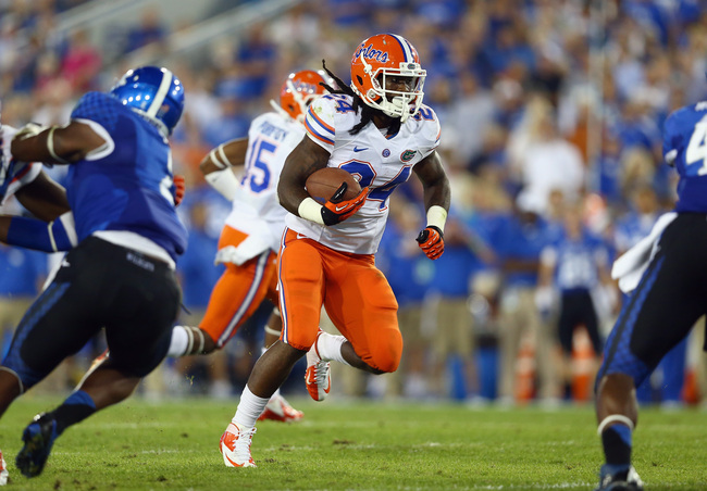 Hi-res-182257916-matt-jones-of-the-florida-gators-runs-with-the-ball_crop_650