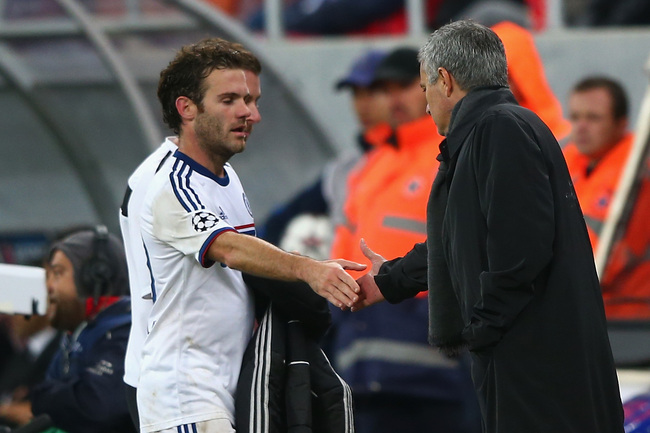 Hi-res-182609087-juan-mata-of-chelsea-shakes-hands-with-manager-jose_crop_650