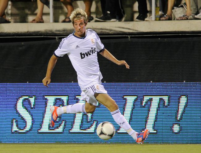 Hi-res-149880293-fabio-coentrao-15-of-real-madrid-cf-brings-the-ball_crop_650