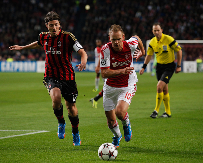 Hi-res-182607772-siem-de-jong-of-ajax-gets-past-riccardo-montolivo-of-ac_crop_650