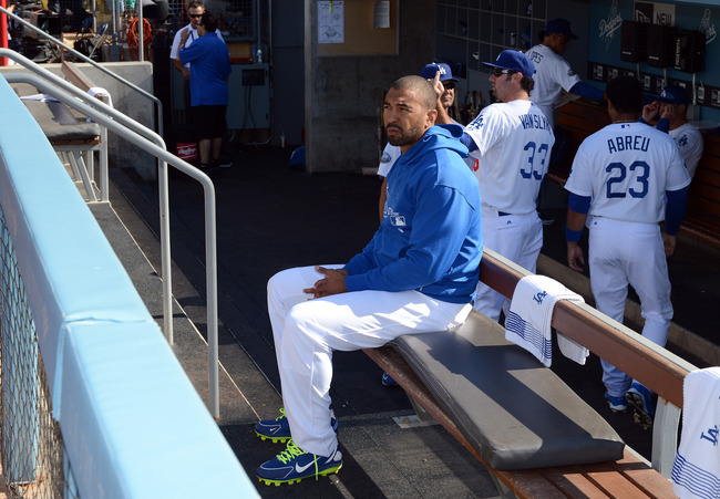 Hi-res-147543788-matt-kemp-of-the-los-angeles-dodgers-sits-on-the-bench_crop_650