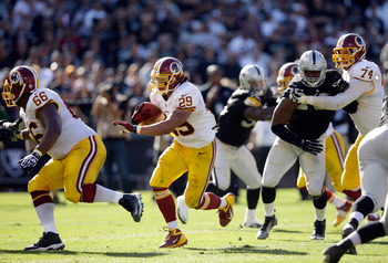Hi-res-182407110-roy-helu-of-the-washington-redskins-runs-with-the-ball_display_image