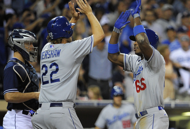 Hi-res-181499306-yasiel-puig-of-the-los-angeles-dodgers-is-congratulated_crop_650x440