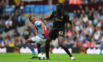 Hi-res-182104871-manchester-city-player-yaya-toure-holds-off-villa_display_image