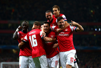 Hi-res-182601306-mesut-oezil-of-arsenal-is-congratulated-by-teammates_display_image