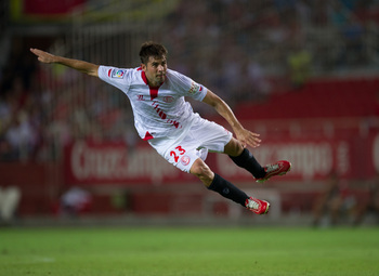 Hi-res-181816180-coke-andujar-of-sevilla-fc-has-a-shot-at-goal-during_display_image