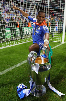 Hi-res-144818844-didier-drogba-of-chelsea-celebrates-with-the-trophy_display_image