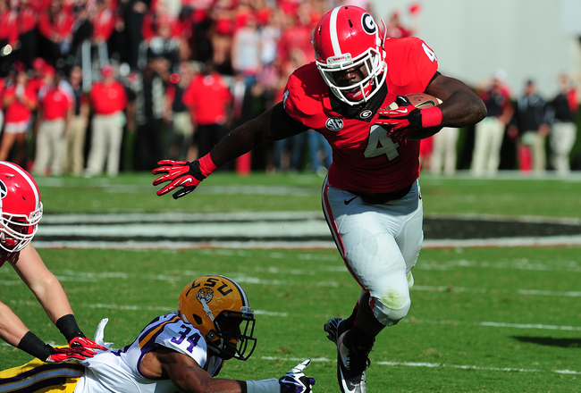 Hi-res-182258598-keith-marshall-of-the-georgia-bulldogs-carries-the-ball_crop_650x440