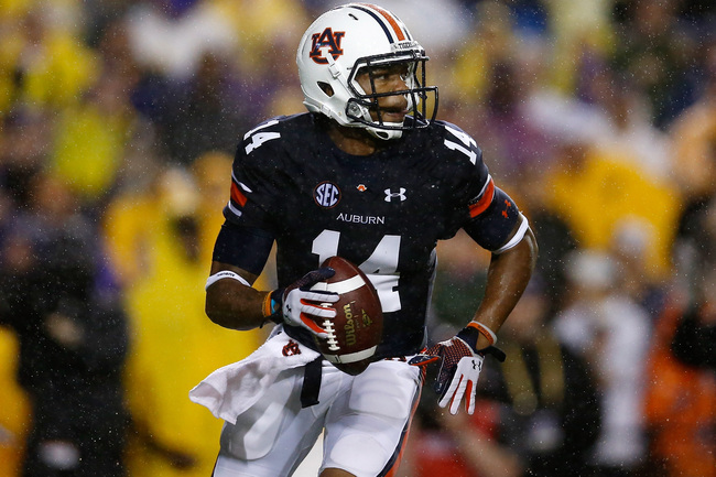 Hi-res-181493331-nick-marshall-of-the-auburn-tigers-looks-to-throw-a_crop_650