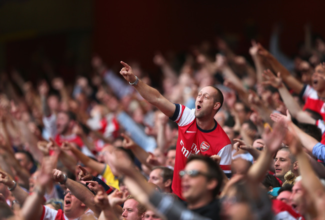 Hi-res-179195751-arsenal-fans-celebrate-victory-after-the-barclays_crop_650x440