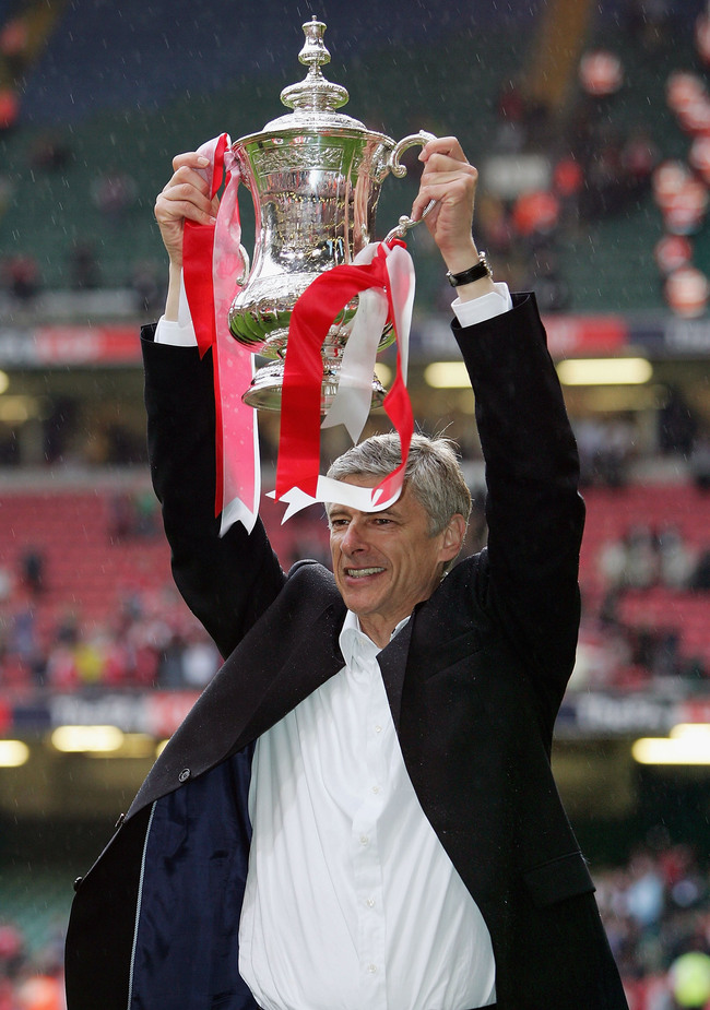 Hi-res-52962611-arsenal-manager-arsene-wenger-holds-aloft-the-trophy_crop_650