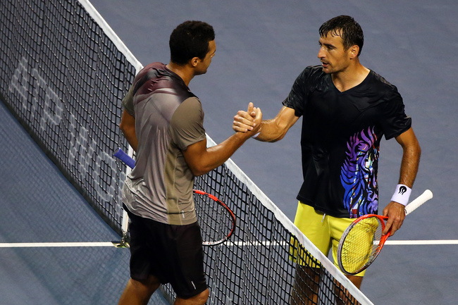 Hi-res-182632195-ivan-dodig-of-croatia-shakes-hands-with-jo-wilfried_crop_650