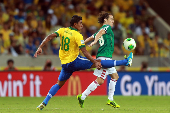 Hi-res-170888133-paulinho-of-brazil-challenges-andres-guardado-of-mexico_crop_650