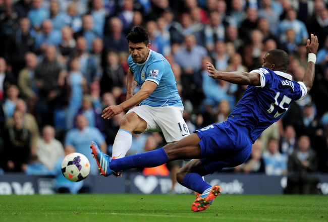 Hi-res-183151055-sergio-aguero-of-manchester-city-shoots-past-sylvain_crop_650x440