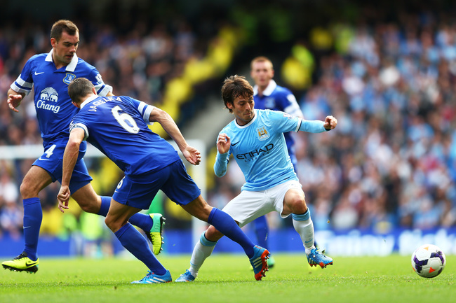 Hi-res-183151578-david-silva-of-manchester-city-is-challenged-by-phil_crop_650