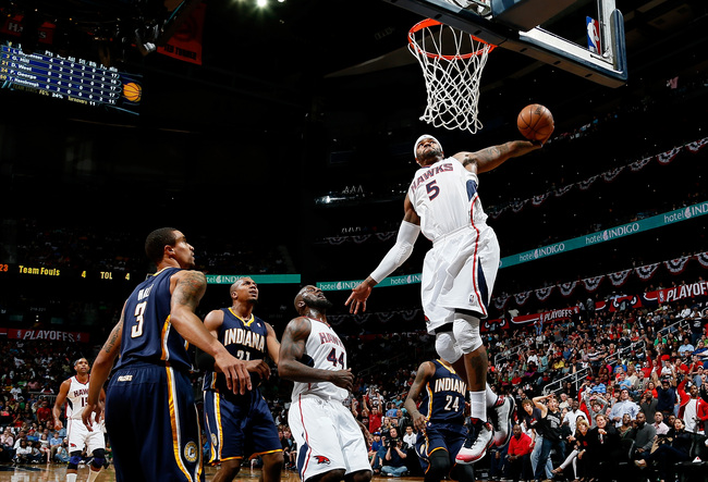 Hi-res-167677685-josh-smith-of-the-atlanta-hawks-dunks-on-david-west-and_crop_650