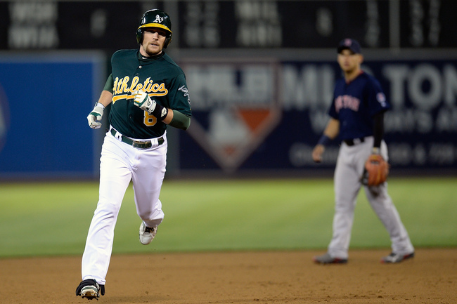 Hi-res-173379179-jed-lowrie-of-the-oakland-athletics-rounds-the-bases_crop_650