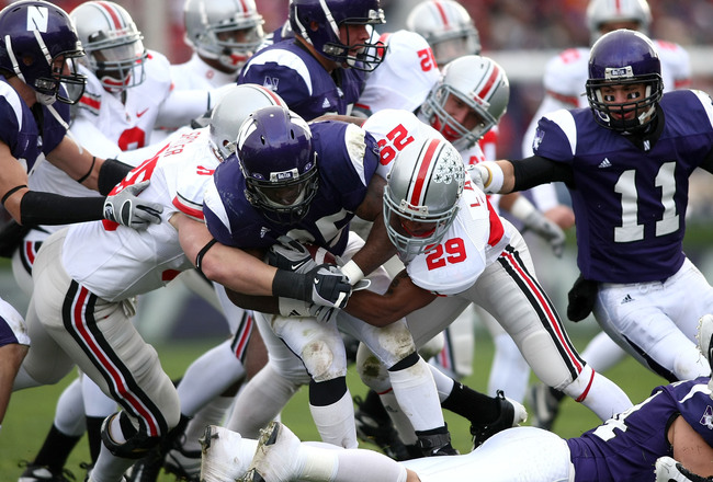 Hi-res-83613250-stephan-simmons-of-the-northwestern-wildcats-is-tackled_crop_650x440