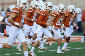 Hi-res-181545294-case-mccoy-of-the-texas-longhorns-runs-on-the-field_display_image
