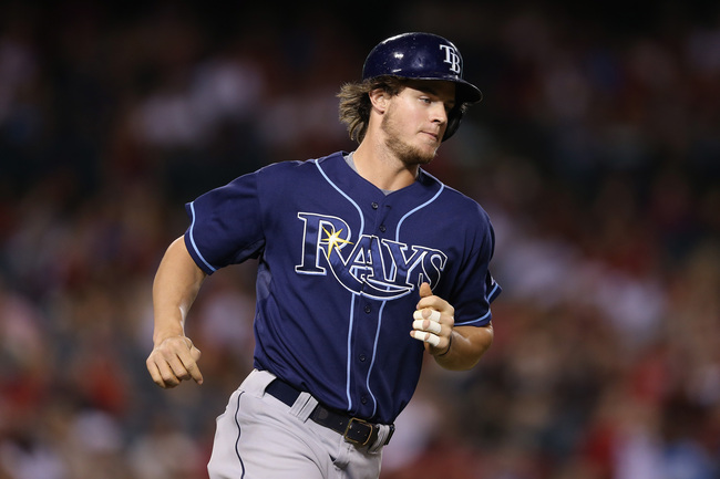 Hi-res-179528945-wil-myers-of-the-tampa-bay-rays-rounds-first-base-after_crop_650