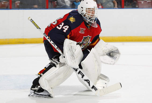 Hi-res-182257838-goaltender-tim-thomas-of-the-florida-panthers-defends_crop_650x440