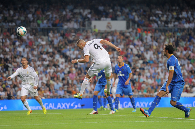 Hi-res-181569650-karim-benzema-of-real-madrid-heads-the-ball-during-the_crop_650