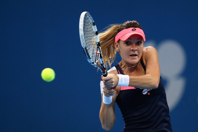 Hi-res-182635840-agnieszka-radwanska-of-poland-returns-a-shot-during-her_crop_650