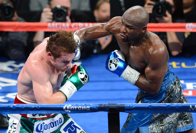Hi-res-180623595-floyd-mayweather-jr-hits-canelo-alvarez-in-the-fifth_crop_650x440