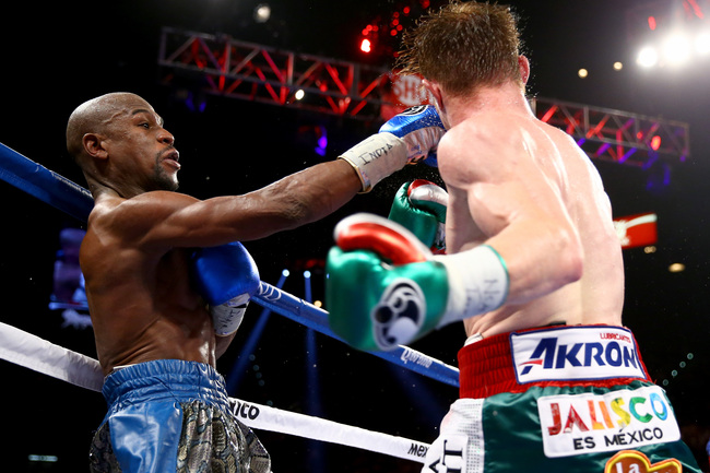 Hi-res-180593947-floyd-mayweather-jr-throws-a-right-to-the-head-of_crop_650