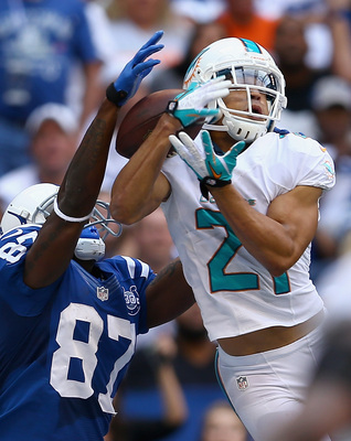 Hi-res-180651329-brent-grimes-of-the-miami-dolphins-intercepts-a-pass_display_image