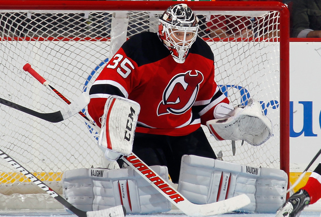Hi-res-181951650-cory-schneider-of-the-new-jersey-devils-steers-the-puck_crop_650x440