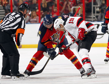 Hi-res-165113036-travis-zajac-of-the-new-jersey-devils-faces-off-against_display_image