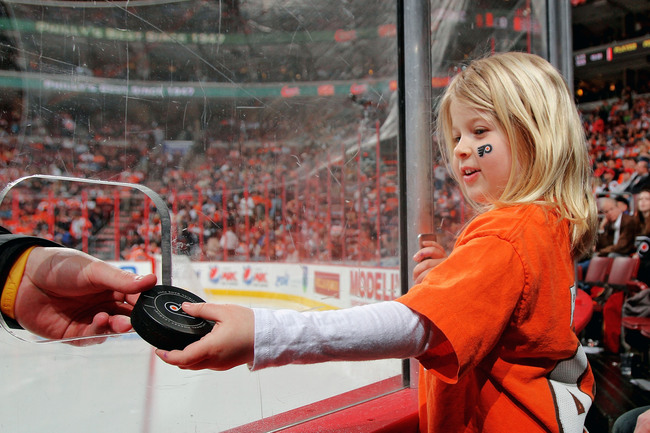 Hi-res-111498650-young-fan-of-the-philadelphia-flyers-receives-a-puck_crop_650