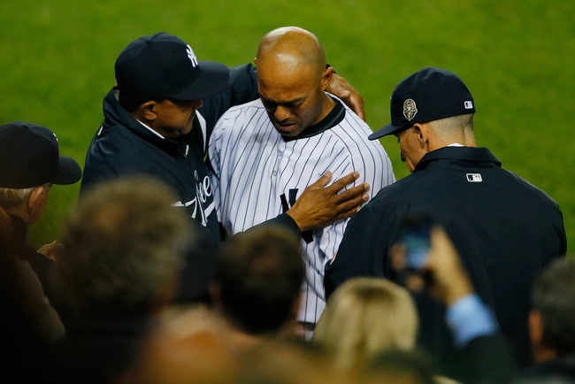 Hi-res-181965177-mariano-rivera-of-the-new-york-yankees-hugs-manager-joe_crop_650