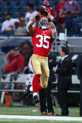 Eric Reid hauls in an interception.