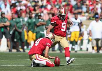 Phil Dawson attempts a kick against the Packers.