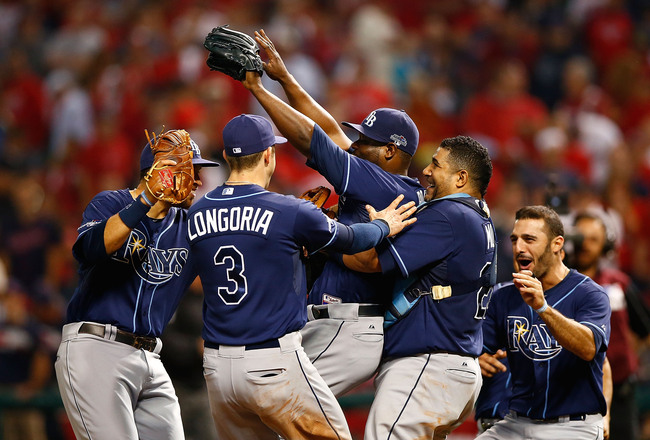 Hi-res-182964712-fernando-rodney-evan-longoria-and-jose-molina-of-the_crop_650x440