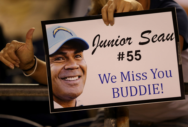 Hi-res-150080465-fan-holds-up-a-sign-honoring-late-san-diego-chargers_crop_650x440