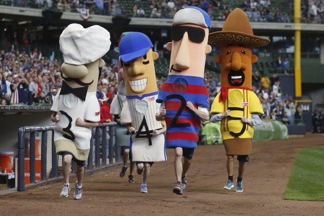 Hi-res-142593650-the-racing-sausages-run-around-the-field-during-the-st_crop_650
