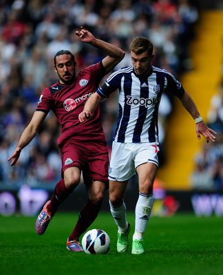 Hi-res-167099635-newcastle-player-jonas-gutierrez-challenges-wba-player_display_image