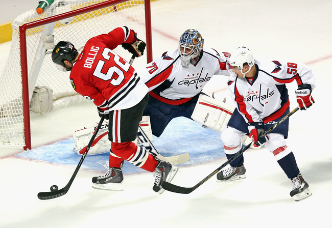 Hi-res-182616925-brandon-bollig-of-the-chicago-blackhawks-puts-a-shot_crop_650