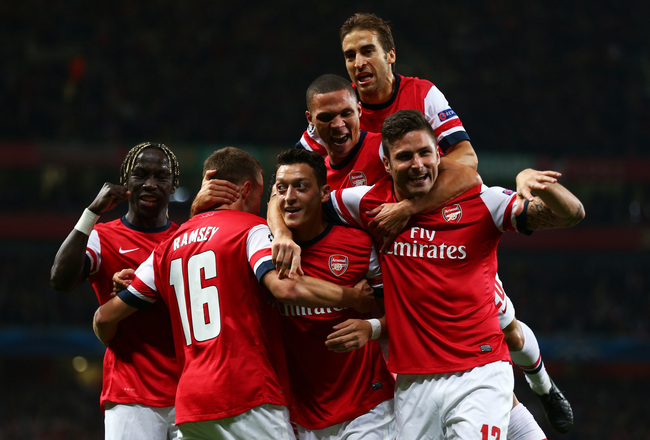 Hi-res-182601297-mesut-oezil-of-arsenal-is-congratulated-by-teammates_crop_650x440