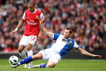 Hi-res-111435313-brett-emerton-of-blackburn-challenges-gael-clichy-of_display_image