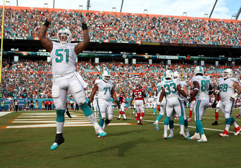 Hi-res-181577245-center-mike-pouncey-of-the-miami-dolphins-celebrates-a_display_image