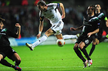 Hi-res-183001276-swansea-player-michu-has-a-shot-blocked-during-the-uefa_display_image