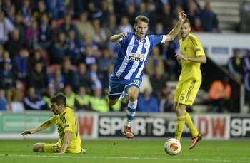 Hi-res-183002615-nick-powell-of-wigan-gets-past-alexsander-rajcevic-of_display_image