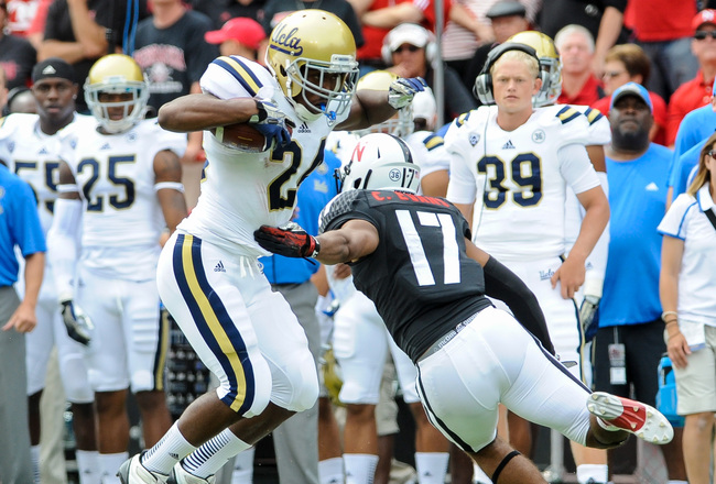 Hi-res-180922300-running-back-paul-perkins-of-the-ucla-bruins-slips-by_crop_650x440