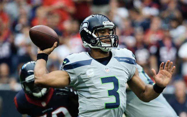 Hi-res-182297564-russell-wilson-of-the-seattle-seahawks-looks-to-pass-in_crop_650
