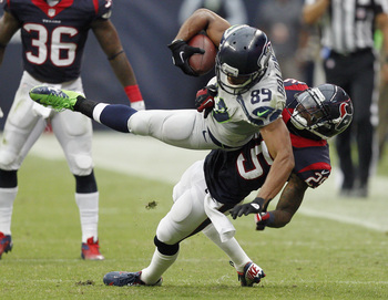 Hi-res-182388013-doug-baldwin-of-the-seattle-seahawks-is-thrown-to-the_display_image